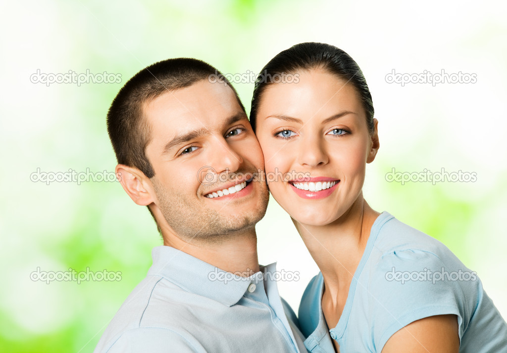 Portrait of young happy smiling attractive couple, outdoors — Stock Photo #11931068