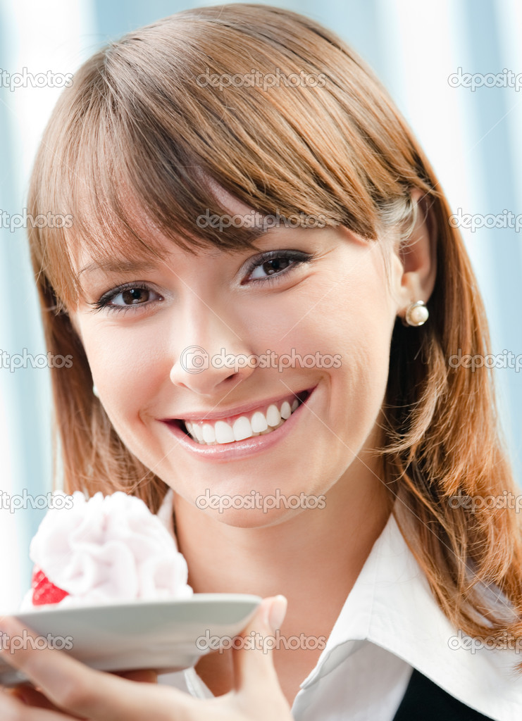 Cheerful smiling business woman with cake at office  Stock Photo #11931177
