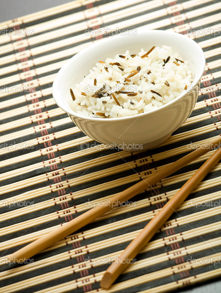 Plate with rice and chopsticks — Stock Photo #11933918
