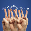 Happy finger and icons — Stock Photo