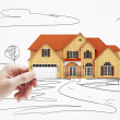 Cottage model in hand — Stock Photo