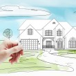 Model cottage in hand — Stock Photo
