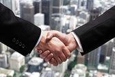 Handshake in city — Stock Photo