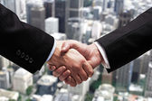 Handshake in city — Stock Photo