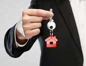 Red key chain with key — Stock Photo