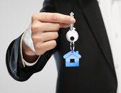 Blue key chain with key — Stock Photo