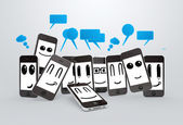 Phones smileys with speech bubbles — Stock Photo