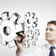 Stock Photo: Businessman drawing cog wheel