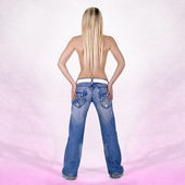 Sexy back of a blonde head woman wearing jeans — Stock Photo