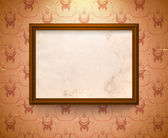 Aged frame on the wall — Stock Vector