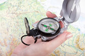 Woman's hand holding a compass — Stock Photo