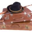 Vintage suitcases with walking stick and hat — Stock Photo