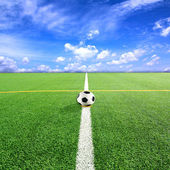 Football or Soccer field and bule sky — Stock Photo