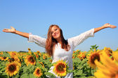 Happy woman in beauty field with sunflowers — Stock Photo