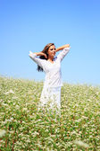 Happy woman in beauty field with white flowers — Stock Photo