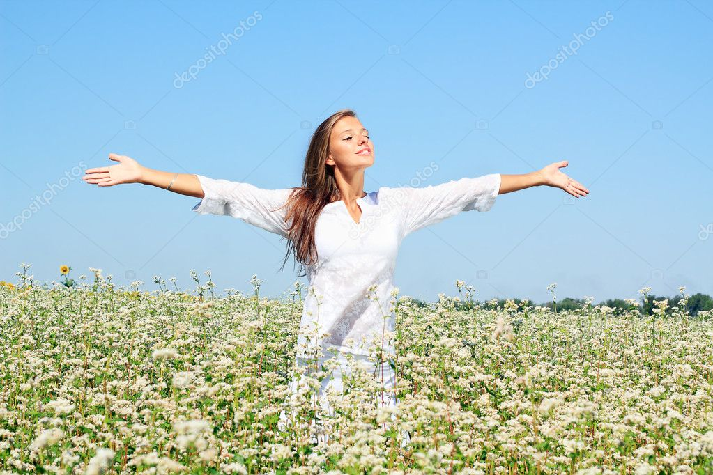 Happy woman in beauty field with white flowers  Stock Photo #11941011