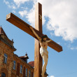 Crucified on a wooden cross — Stock Photo