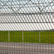 Barbed wire on the fence — Stock Photo #11023659