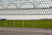 Barbed wire on the fence — Stock Photo