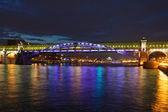 Illuminated pedestrian bridge — Stock Photo