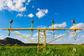 Landing lights and green grass — Stock Photo