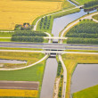 Dutch farm landscape with infrastructure road and canal — Stok fotoğraf