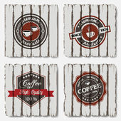 Coffee labels on old wood background — Stock Vector