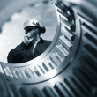 Engineer and giant gears - Stock Photo