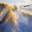 Airliner flying over dramatic clouds — Stock Photo