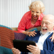 Tablet PC - Senior Couple Laughing - Zdjęcie stockowe