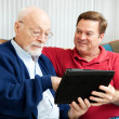 Teaching Dad to Use Tablet PC — Foto Stock #11048410