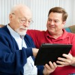 Teaching Dad to Use Tablet PC — Stock Photo #11048410