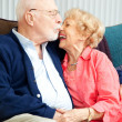 Senior Couple Flirting and Laughing - Stock Photo
