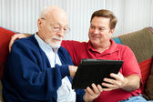 Teaching Dad to Use Tablet PC — Stock Photo