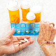 Elderly Hands Sorting Pills - ストック写真