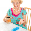 Stock Photo: Smiling Senior WomTakes Medicine