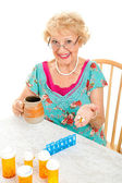 Smiling Senior Woman Takes Medicine — Stock Photo