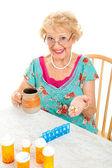 Smiling Senior Woman Takes Medicine — Stock Photo