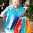 Senior Shopper Inspects Bags — Stock Photo