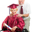 Stock Photo: Disabled Senior Graduate and Husband