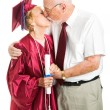 Senior Graduation Couple Kissing - Stock Photo