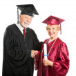 Mature Graduate Receives Diploma - Stock Photo