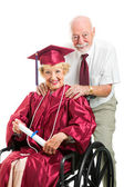 Disabled Senior Graduate and Husband — Stock Photo
