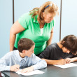 Teacher Supervises Testing — Stock Photo