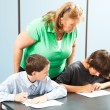 Teacher Supervises Testing - Stock Photo
