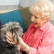 Senior Lady Loves Her Dog - Stock Photo