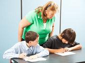 Teacher Supervises Testing — Stock Photo