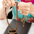 Saying the Rosary - Stock Photo