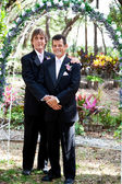 Gay Couple Under Wedding Arch — Stock Photo