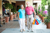 Shopping Hand-in-Hand — Stock Photo